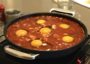 Eggs simmering in Shakshuka Base